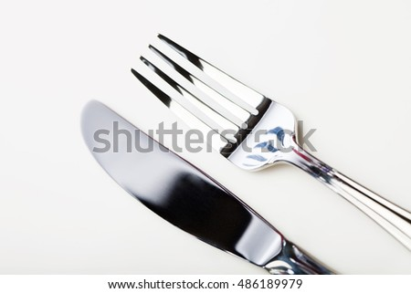 Close up of knife and fork.