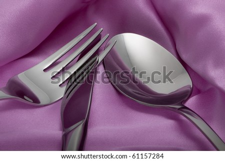 Close-up of knife, fork and spoon on a napkin