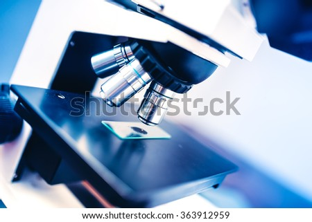 Close-up of laboratory chemical instruments, microscope and samples. Scientific and healthcare domains - stock photo
