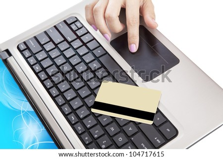 Close up of laptop computer with a credit card and a hand - stock photo