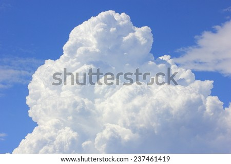 Close up of large fluffy clouds in blue sky