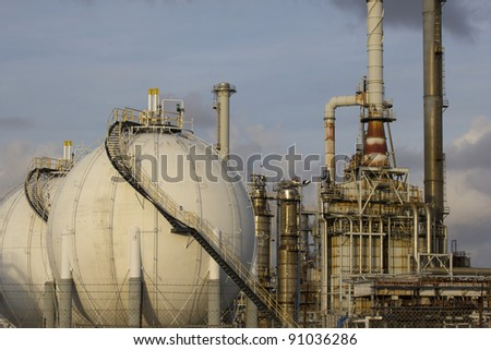Close-up of large gas tanks and a petrochemical plant - stock photo
