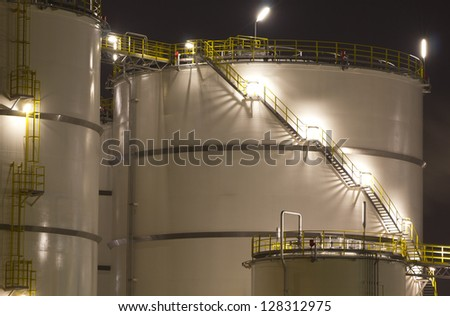 Close-up of large oil-tanks - stock photo