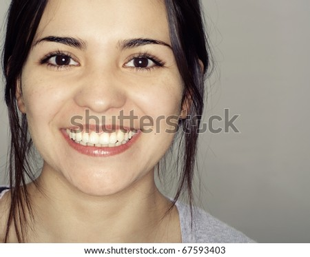 Close up of laughing happy smiling young woman - stock photo