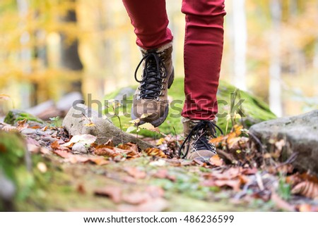 Close up of legs of unrecognizable woman in autumn nature