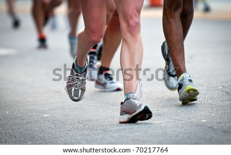 Close up of legs while running, use of selective focus. - stock photo