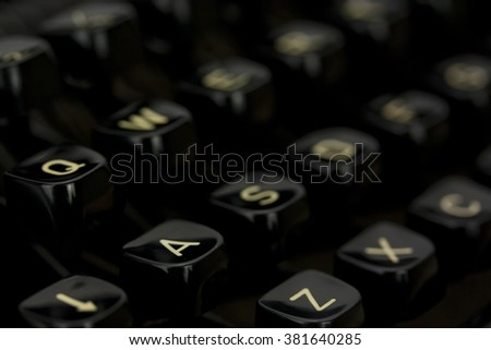 Close up of lettered keys on an old typewriter. Shallow depth of field.