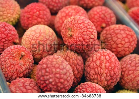 Close up of lichee on market stand - stock photo