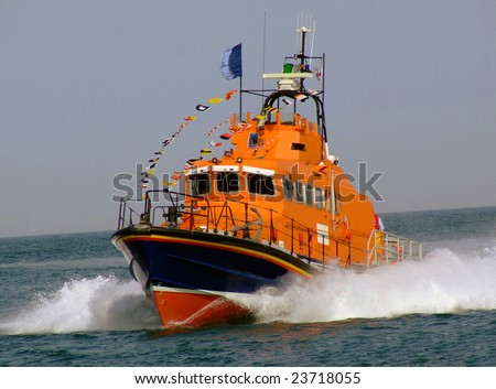 Close up of lifeboat sailing on ocean. - stock photo