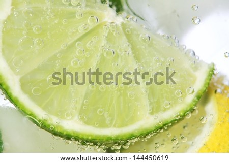 Close-up of lime in drink. - stock photo