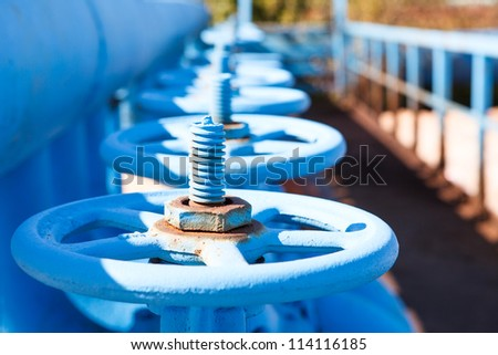 Close up of line from blue vents of oxygen gate valves - stock photo