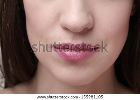 Close-up of lips with make-up on them - stock photo