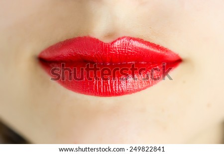 Close-up of lips with red lipstick - stock photo