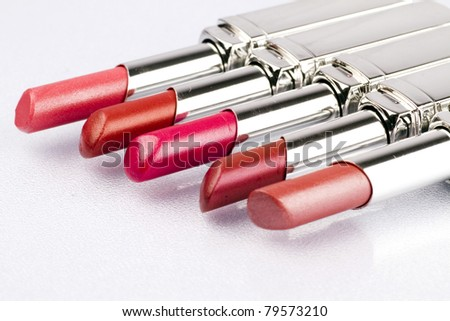 Close up of lipstick on a white background.