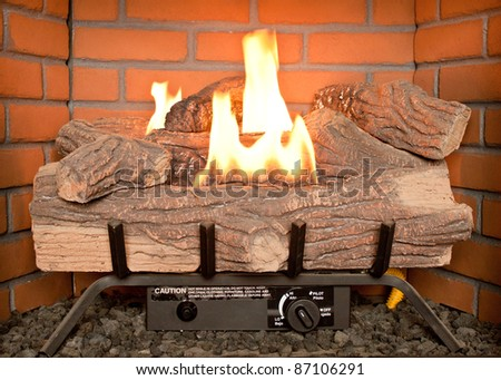 Close-up of lit electric fireplace - stock photo