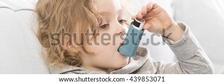 Close-up of little asthmatic child doing inhalation therapy - stock photo