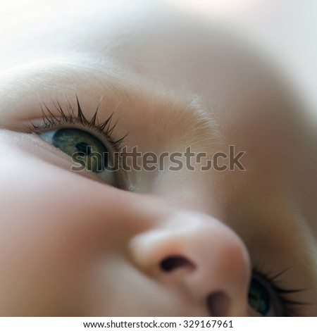 Close-up of little baby eye after crying - stock photo