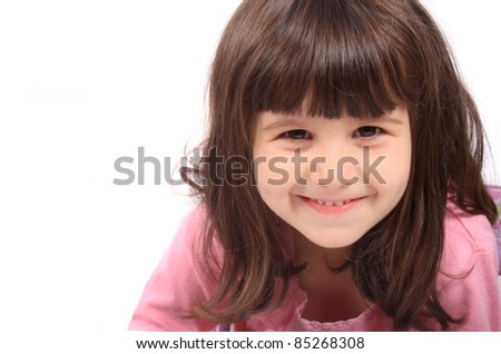Close up of little four year old brunette girl smiling on a white background - stock photo