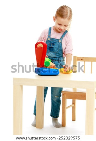 Close up of little girl in denim overalls.Isolated on white background, Lotus Children's Center. - stock photo
