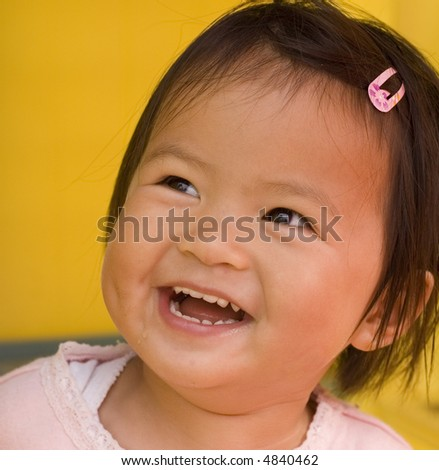 close up of little girl with a big smile - stock photo
