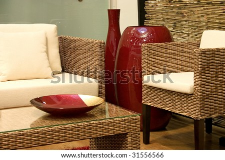 Close up of living room with sofas from rattan and arm chair. - stock photo