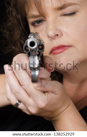 Close up of loaded bun being held by woman - stock photo