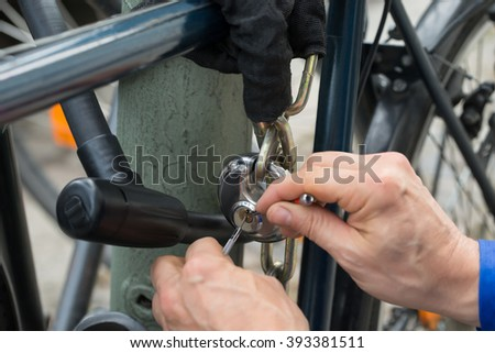 Close-up Of Lockpicker Fixing Lock Of Cycle