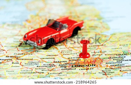 Close up of  London ,United Kingdom  map ,red car and  pin - Travel concept - stock photo
