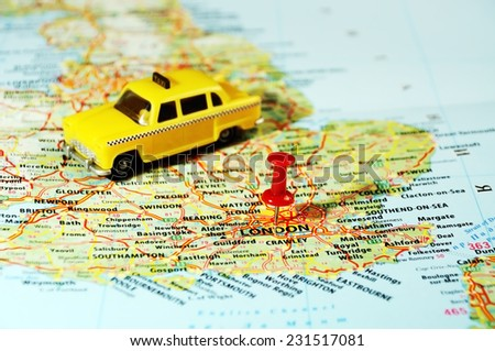 Close up of  London ,United Kingdom  map ,taxi  car and  pin - Travel concept - stock photo