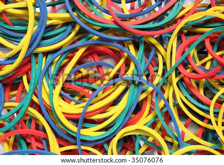 Close up of lots of colorful elastic bands.