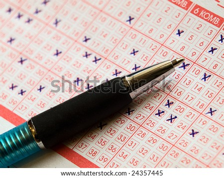 Close up of lottery ticket with a  marked numbers and a  pencil. - stock photo