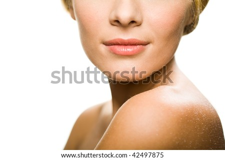 Close-up of lower part of pretty female face - stock photo