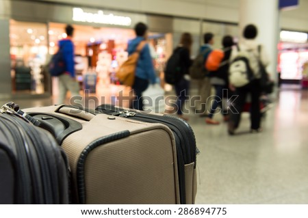 Close up of luggage at airport terminal - stock photo