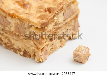 Close up of luncheon meat layer cake on white background. - stock photo