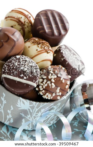 Close up of luxury Christmas chocolates with silver bauble and ribbon - stock photo