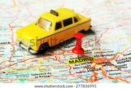 Close up of Madrid  ,Spain map , red pin and taxi toy  - Travel concept - stock photo