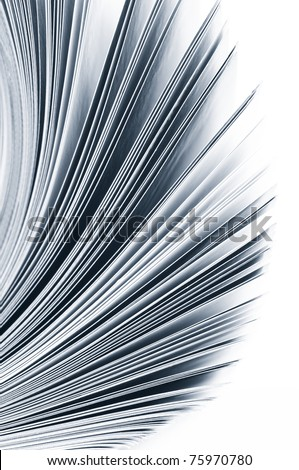 Close-up of magazine pages on white background. Toned monochrome image. Shallow DOF, focus on edges. - stock photo