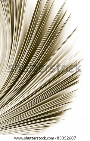 Close-up of magazine pages on white background. Toned monochrome image. Shallow DOF, focus on edges. - stock photo