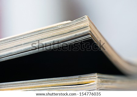 Close-up of magazine pages. Shallow DOF, focus on edges.  - stock photo