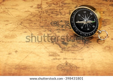 Close Up Of Magnetic Compass On The Old Map, Front View, Horizontal Image - stock photo