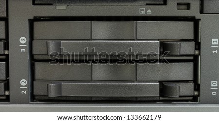 Close up of magnetic tape backup drive in data center - stock photo