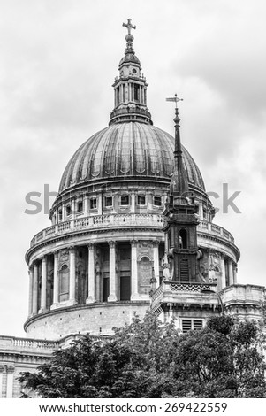 Close up of Magnificent St. Paul Cathedral in London. It sits at top of Ludgate Hill - highest point in City of London. Cathedral was built by Christopher Wren between 1675 and 1711. Black and white.