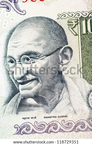 Close up of Mahatma Gandhi on Indian currency - stock photo