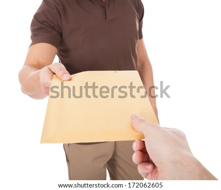 Close-up Of Mailman Delivering Mail To Person Over White Background