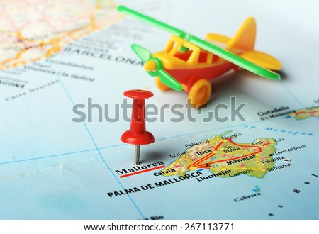 Close up of  Majorca  island , Spain  map  pin and airplane toy - stock photo
