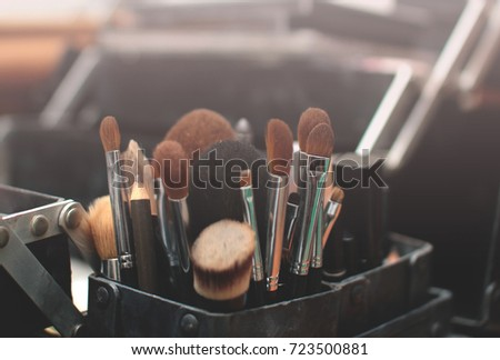 Close up of make up brush and tools in their holder. Vintage editing. Selective focus
