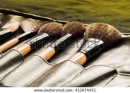 Close Up of makeup brush in black slot holder - stock photo
