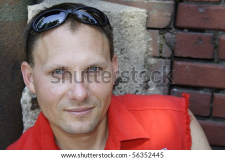 Close up of male biker with sunglasses on head. - stock photo