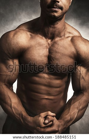 Close-up of male bodybuilder - stock photo
