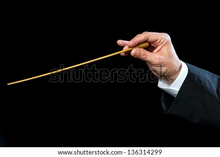 Close up of male conductors hand directing. - stock photo